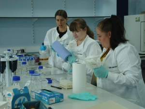 Discussing sterile techniques with lab volunteers in Liverpool