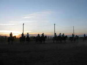 Cowboys by sunset at the local rodeo