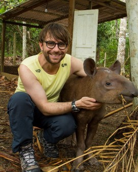 """James Russell wins the annual """"Cutest critter cuddle"""" award 2017 for his picture with this tapir"""